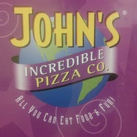 Photo taken at John's Incredible Pizza Company by Whitney S. on 3/9/2013