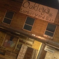 Photo taken at Oakley's Lumberyard Bar by Elizabeth G. on 3/8/2013