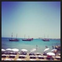 Photo taken at Escape Beach Club by Okan O. on 7/6/2013
