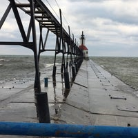 Photo taken at St. Joseph North Pier (at Tiscornia Park) by Christy T. on 12/31/2016
