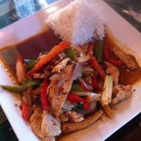 Photo taken at Thai Thani Restaurant by Danielle S. on 5/23/2013