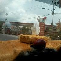 Photo taken at Jalan Raya Airmadidi - Manado by Vilia R. on 4/12/2013