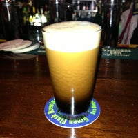 Photo taken at Flanagan's Pub by Nicholas M. on 3/18/2013
