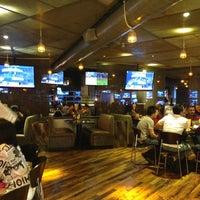 Photo taken at Bombshells Restaurant & Bar by Devin G. on 8/10/2013