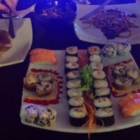 Photo taken at Sushi Bar Kazuco by Gabriela C. on 4/12/2014