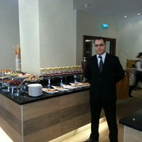 Photo taken at Olives Restaurant by Oussema E. on 3/7/2013