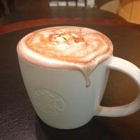Photo taken at Starbucks by にゃりんこ こ. on 7/21/2013