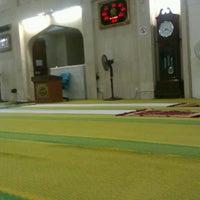 Photo taken at Masjid Al-Mujahideen by Izzuddin S. on 3/31/2012