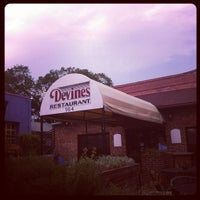 Photo taken at Devines Restaurant & Sports Bar by Amy J. on 7/4/2012