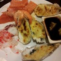 Photo taken at Shogun Japanese Buffet Restaurant by Eelaine H. on 12/19/2011