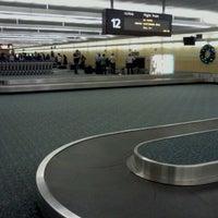 Photo taken at Orlando International Baggage Claim by Chad M. on 12/20/2011