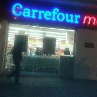Photo taken at Carrefour Market by Anna P. on 12/27/2011