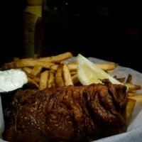 Photo taken at Madra Rua Irish Pub by Anna K. on 4/3/2012