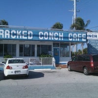 Photo taken at Cracked Conch Cafe by Jennifer H. on 1/15/2011