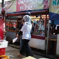 Photo taken at Pusat Jajanan Bintaro by Gery D. on 3/11/2012