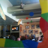 Photo taken at Bongo Johnny's Patio Bar and Grille by Bob S. on 5/23/2012