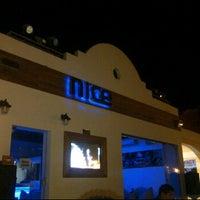Photo taken at NICE Lounge Bar & Restaurant by Ayman N. on 10/27/2011