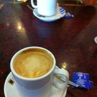 Photo taken at Cafe Bravo by Bertie O. on 3/18/2012