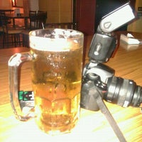 Photo taken at Quattro Bar & Grill by Miguel A. on 6/8/2012