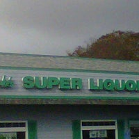 Photo taken at A.J. Luke's Super Liquors by Charlie B. on 10/20/2011