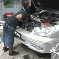 Photo taken at KZ Auto Garage by kんムΐしΐス 。 on 12/27/2011