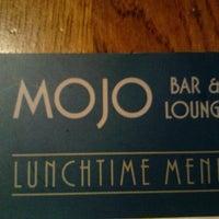 Photo taken at Mojo Bar & Lounge by David M. on 12/16/2011