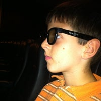 Photo taken at Bow Tie Cinemas Warner Quad by Kathie G. on 5/29/2011