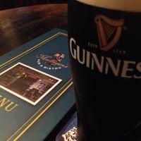Photo taken at Mulligan's Irish Pub by zos S. on 6/22/2012
