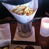 Photo taken at Soluna Cafe by Tom O. on 3/31/2011