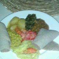Photo taken at Bayu's Authentic Ethiopian Cuisine by Katia H. on 10/19/2011