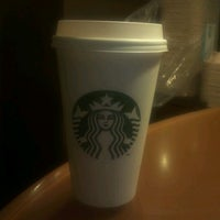 Photo taken at Starbucks by Nina on 4/3/2012