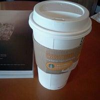 Photo taken at Starbucks by Angie K. on 3/22/2012