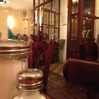 Photo taken at Café Puck by Thomas H. on 9/3/2012
