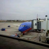 Photo taken at Gate 6 by Kat on 8/5/2012