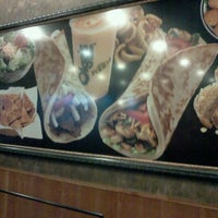 Photo taken at Olga's Kitchen by Starrby W. on 3/8/2012