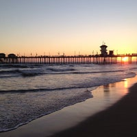 Photo taken at Huntington Beach Pier by べぇ on 7/29/2012