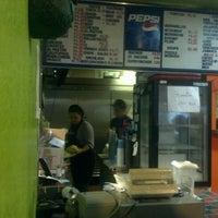 Photo taken at La Playa Taco Shop by Dylan S. on 7/4/2012