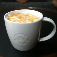 Photo taken at Starbucks by Kornvika K. on 7/8/2012