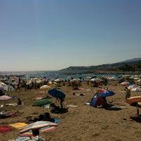 Photo taken at Spiaggia Santo Stefano Al Mare by matteo F. on 8/15/2012