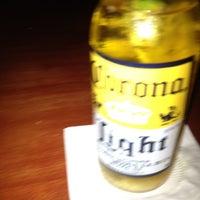 Photo taken at Geckos Bar and Tapas by Jennifer S. on 7/10/2012