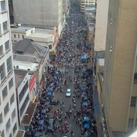 Photo taken at Rua 25 de Março by Jefferson A. on 7/7/2012