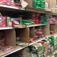 Photo taken at Double Dragon Food Market by Otis K. on 3/10/2012