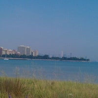 Photo taken at 63rd Street Beach by Elisha V. on 8/25/2012