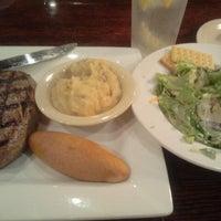 Photo taken at 13 Bones - Ribs - Seafood - Steak by Nicole S. on 8/16/2012