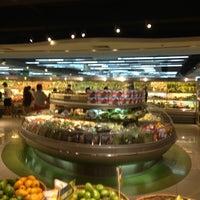 Photo taken at The Landmark Supermarket by Chris C. on 3/26/2013
