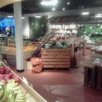 Photo taken at Living Green Fresh Market by Carla X. on 3/12/2013