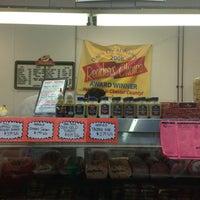 Photo taken at Colonial Village Meat Market by Dan G. on 3/21/2013