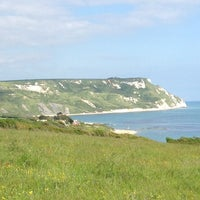 Photo taken at Ringstead Bay by Jim K. on 6/9/2013