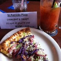 Photo taken at Schmizza Pub & Grub by Angie H. on 3/16/2013