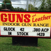 Photo taken at Guns And Leather by Tisma J. on 9/11/2014